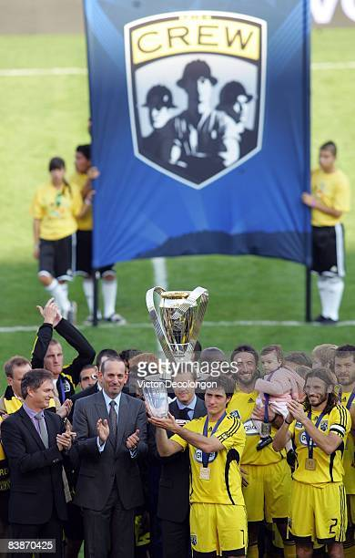 Guillermo Barros Schelotto of the Columbus Crew pose holds up the game MVP trophy on the podium after defeating the New York Red Bulls 31 in the 2008...
