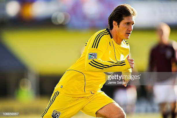 Guillermo Barros Schelotto of the Columbus Crew runs upfield against the Colorado Rapids during the second leg of the MLS playoff match on November 6...