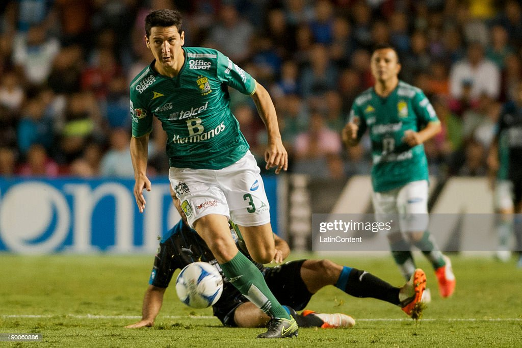 Guillermo Burdisso of Leon drives the ball during a 10th round match between Queretaro and Leon as part of the Apertura 2015 Liga MX at La...