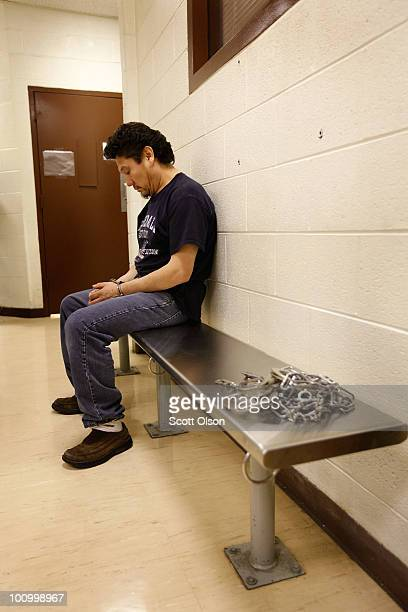 Guillermo CamposOjeda sits shackled as he waits to be taken to a deportation flight chartered by US Immigration and Customs Enforcement May 25 2010...