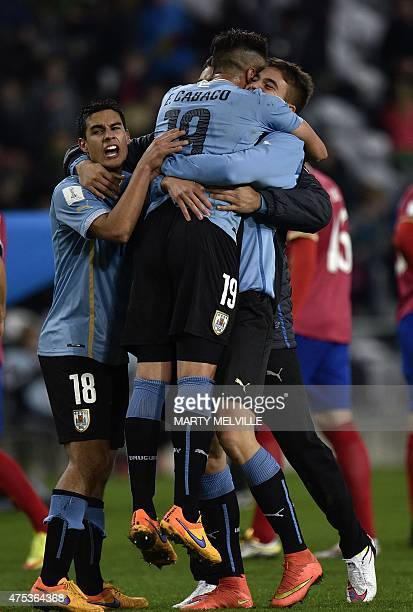 Guillermo Cotugno of Uruguay celebrates their win with teammates Erick Cabaco and Agustin Ale after the FIFA Under20 World Cup football match between...