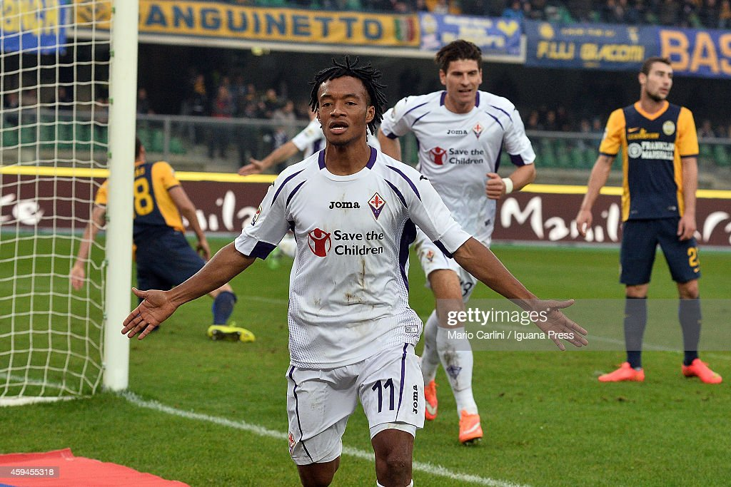 Guillermo Cuadrado # 11 of ACF Fiorentina celebrates after scoring his team's second goal during the Serie A match between Hellas Verona FC and ACF Fiorentina at Stadio Marc'Antonio Bentegodi on November 23, 2014 in Verona, Italy.
