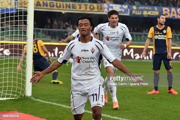 Guillermo Cuadrado of ACF Fiorentina celebrates after scoring his team's second goal during the Serie A match between Hellas Verona FC and ACF...
