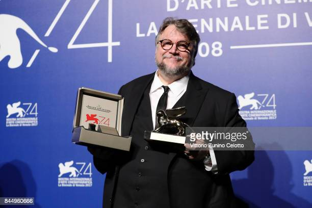 Guillermo del Toro poses with the Golden Lion for Best Film Award for 'The Shape Of Water' at the Award Winners photocall during the 74th Venice Film...