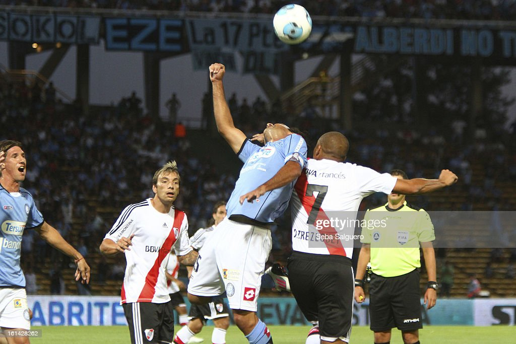 Guillermo Farre of Belgrano fights for the ball with David Trezeguet of River during the match between Belgrano and River for the Torneo Final 2013 on February 10, 2013 in Cordoba, Argentina.
