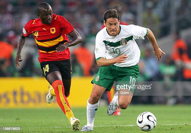 Guillermo Franco of Mexico races away from Mendonca of Angola as the teams played to a 00 tie in a Group D game in FIFA World Cup Stadium Hanover...
