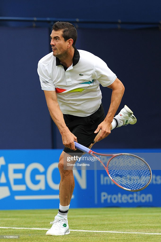 <a gi-track='captionPersonalityLinkClicked' href=/galleries/search?phrase=Guillermo+Garcia+Lopez&family=editorial&specificpeople=687311 ng-click='$event.stopPropagation()'>Guillermo Garcia Lopez</a> of Spain reacts during his Men's Singles first round match against Xavier Malisse of Belgium on day one of the AEGON Championships at Queens Club on June 10, 2013 in London, England.