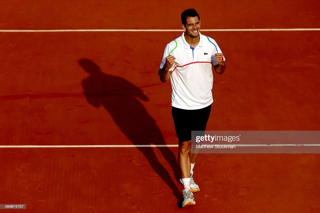 Guillermo Garcia-Lopez of Spain celebrates victory in his men's singles match against Donald Young of the United States on day seven of the French Open at Roland Garros on May 31, 2014 in Paris, France.