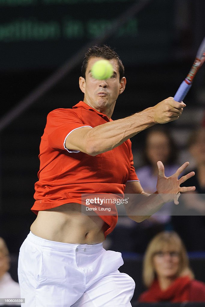 Guillermo Garcia-Lopez of Spain eyes the ball during his singles match against Milos Raonic of Canada on day three of the 2013 Davis Cup on February 3, 2013 at UBC Thunderbird Arena in Vancouver, British Columbia, Canada.