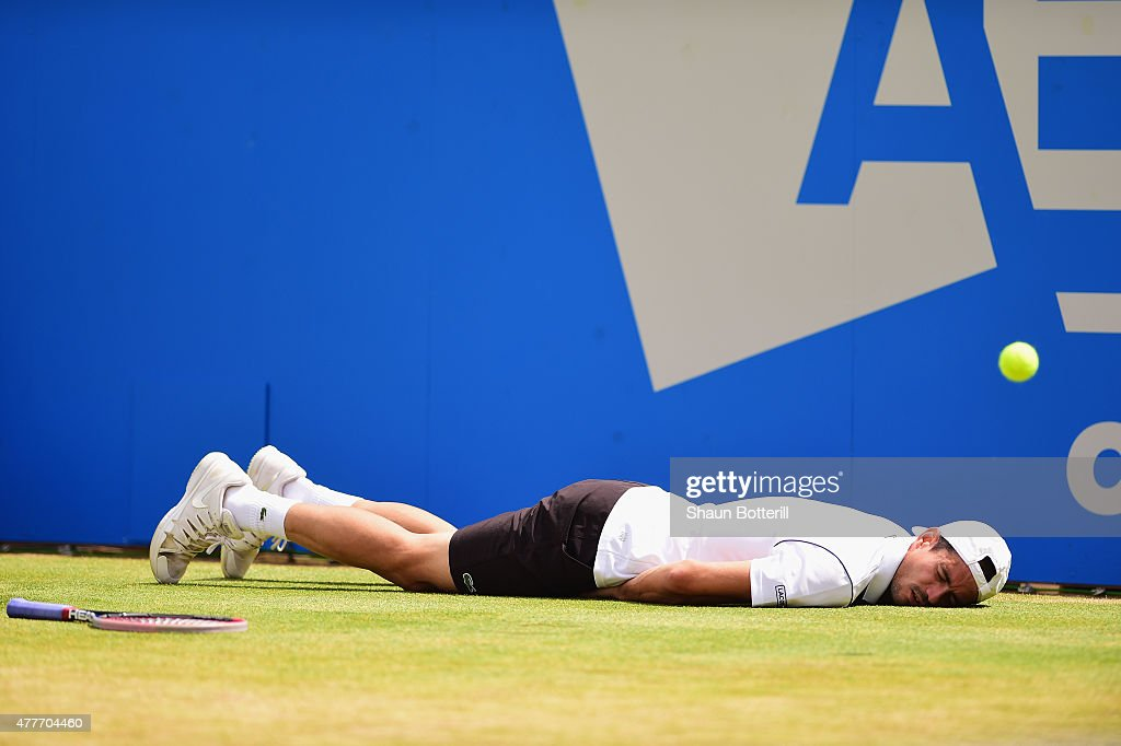 Guillermo Garcia-Lopez of Spain falls to the ground in his men's singles quarter-final match against Kevin Anderson of South Africa during day five of the Aegon Championships at Queen's Club on June 19, 2015 in London, England.