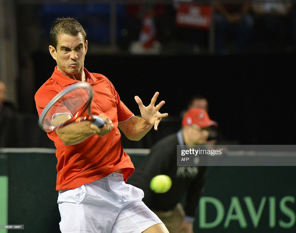 Guillermo Garcia-Lopez of Spain hits a return to Milos Raonic of Canada in a Davis Cup World Group first round match on February 3, 2019 at the Doug Mitchell Thunderbird Sports Centre in Vancouver. Raonic won 6-3, 6-4, 6-2 to send Canada into their first Davis Cup quarter-final. AFP PHOTO/Don MacKinnon