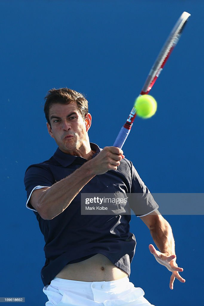 Guillermo Garcia-Lopez of Spain plays a forehand in his first round match against Rajeev Ram of the United States of America during day two of the 2013 Australian Open at Melbourne Park on January 15, 2013 in Melbourne, Australia.