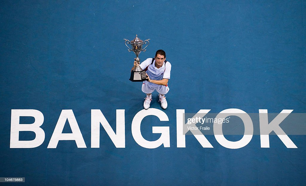 Guillermo Garcia-Lopez of Spain poses with the trophy after winning the singles final match against Jarkko Nieminen of Finland on Day 9 of the PTT Thailand Open at Impact Arena on October 3, 2010 in Bangkok, Thailand.