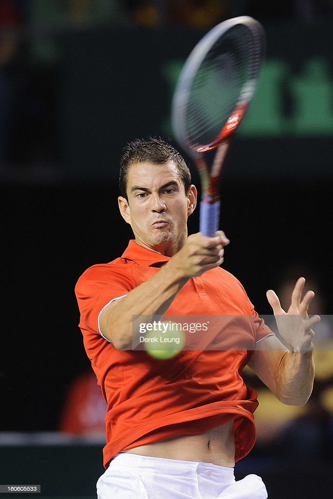 Guillermo Garcia-Lopez of Spain returns during his singles match against Milos Raonic of Canada on day three of the 2013 Davis Cup on February 3, 2013 at UBC Thunderbird Arena in Vancouver, British Columbia, Canada.