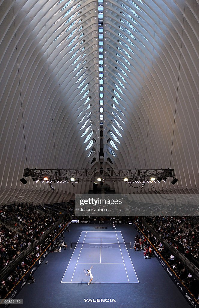 Guillermo Garcia-Lopez (Bottem) of Spain serves the ball in his quarter final match against <a gi-track='captionPersonalityLinkClicked' href=/galleries/search?phrase=Nikolay+Davydenko&family=editorial&specificpeople=178192 ng-click='$event.stopPropagation()'>Nikolay Davydenko</a> of Russia during the ATP 500 World Tour Valencia Open tennis tournament at the Ciudad de las Artes y las Ciencias on November 6, 2009 in Valencia, Spain.