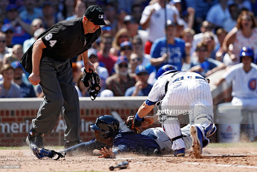 Guillermo Heredia #5 of the Seattle Mariners is tagged out at home plate by Miguel Montero #47 of the Chicago Cubs in the eighth inning at Wrigley Field on July 30, 2016 in Chicago, Illinois. The Mariners defeated the Cubs 4-1.