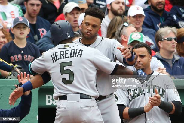 Guillermo Heredia of the Seattle Mariners returns to the dugout after hitting a solo home run in the eighth inning of a game against the Boston Red...