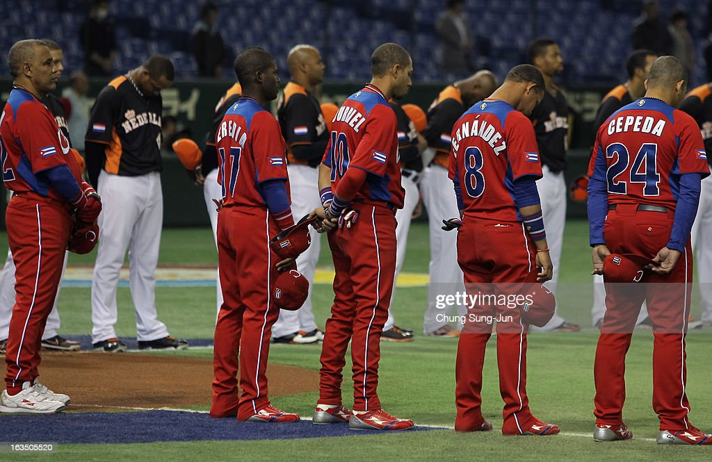 Guillermo Heredia # 17, Yulieski Gourriel # 10, Jose Fernandez # 8, Frederich Cepeda # 24 and Netherlands players pay silent tribute to mark Japan's second anniversary of the 2011 Magnitude 9.0 earthquake and sebsequent tsunami before the the World Baseball Classic Second Round Pool 1 game between Cuba and the Netherlands at Tokyo Dome on March 11, 2013 in Tokyo, Japan.