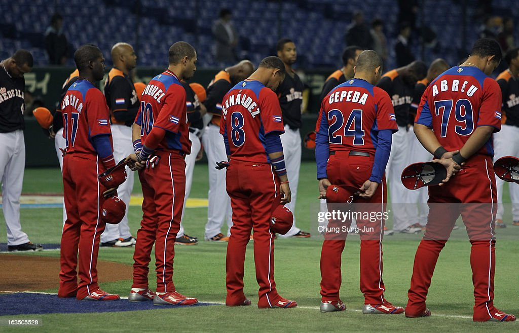Guillermo Heredia # 17, Yulieski Gourriel # 10, Jose Fernandez # 8, Frederich Cepeda # 24, Jose Abreu # 79 and Netherlands players pay silent tribute to mark Japan's second anniversary of the 2011 Magnitude 9.0 earthquake and sebsequent tsunami before the the World Baseball Classic Second Round Pool 1 game between Cuba and the Netherlands at Tokyo Dome on March 11, 2013 in Tokyo, Japan.