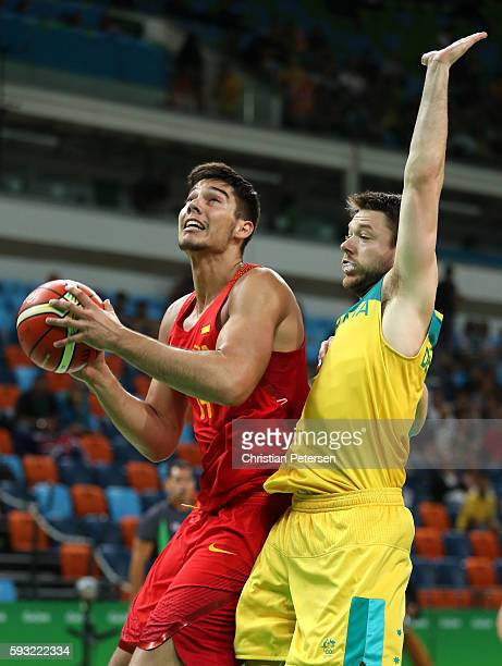 Guillermo Hernangomez Geuer of Spain drives to the basket against Matthew Dellavedova of Australia during the Men's Basketball Bronze medal game...