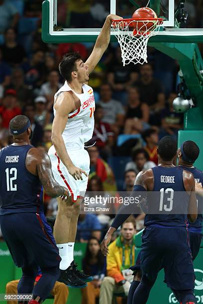 Guillermo Hernangomez Geuer of Spain dunks against Demarcus Cousins and Paul George of United States during the Men's Semifinal match on Day 14 of...
