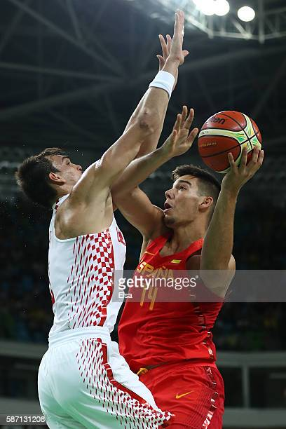 Guillermo Hernangomez Geuer of Spain is blocked by Dario Saric of Croatia during a Men's preliminary round basketball game between Croatia and Spain...