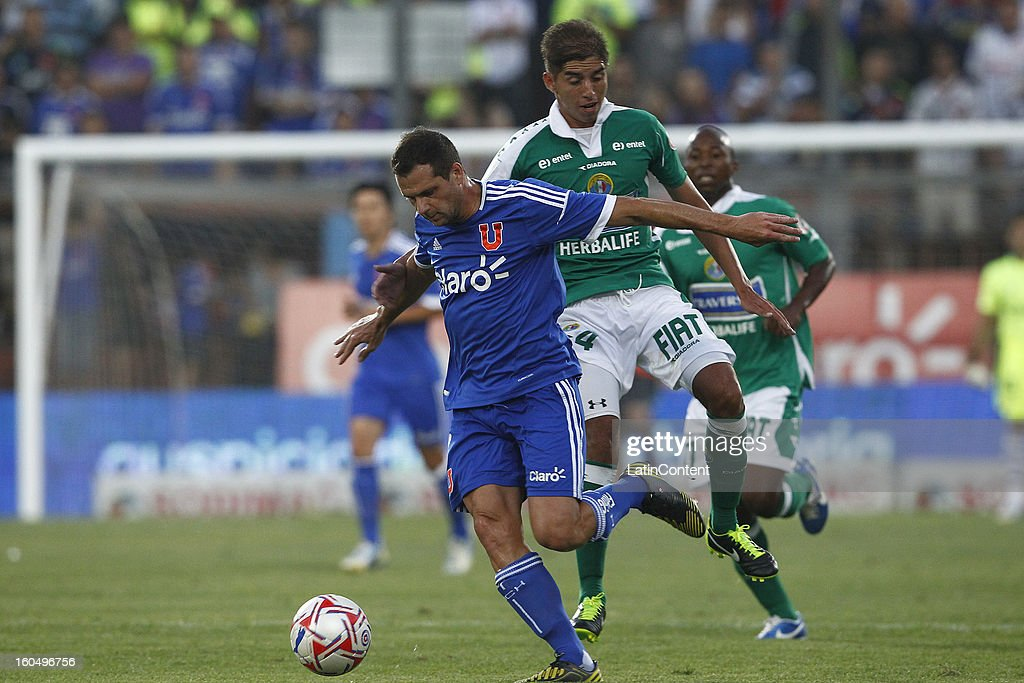 Guillermo Marino of Universidad de Chile fights for the ball with Francisco Gaete of Audax Italiano during a match between Universidad de Chile and Audax Italiano as part of the Torneo Transición 2013 at Santa Laura Stadium on February 01, 2013 in Santiago, Chile.