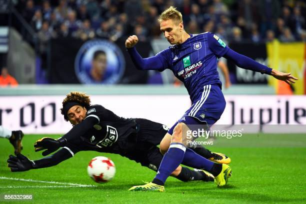 Guillermo Ochoa goalkeeper of Standard Liege Lukasz Teodorczyk forward of RSC Anderlecht during the Jupiler Pro League match between RSC Anderlecht...