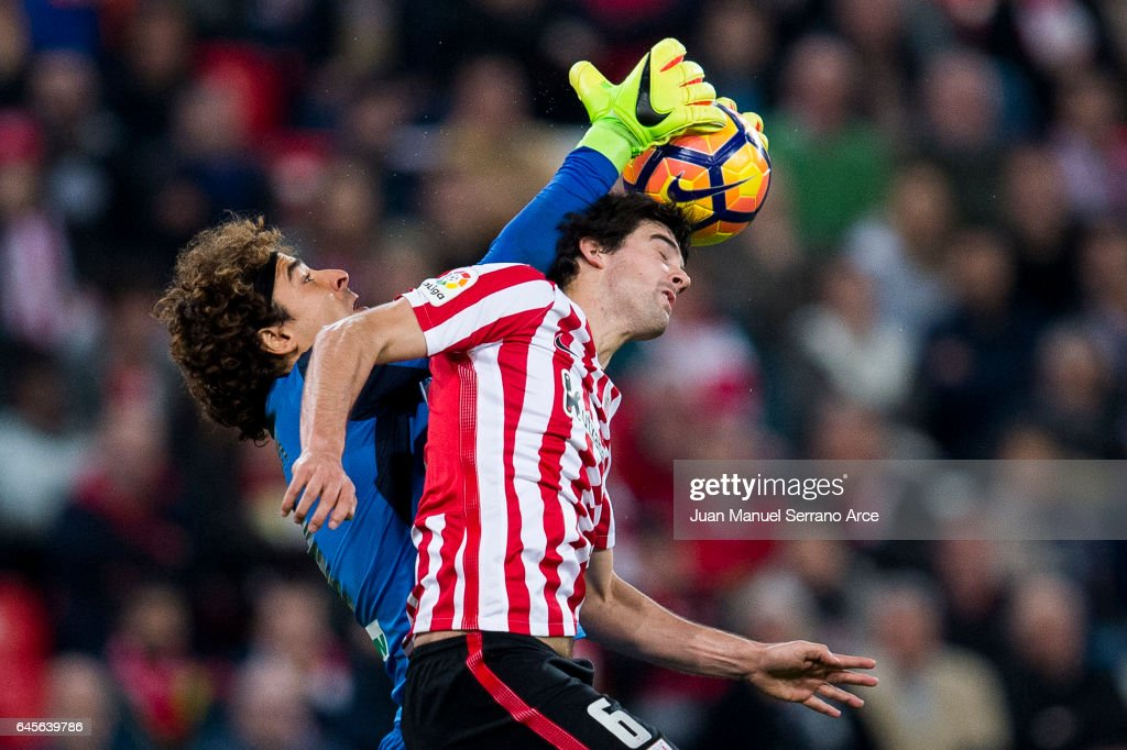 Guillermo Ochoa of Granada CF competes for the ball with Mikel San Jose of Athletic Club during the La Liga match between Athletic Club Bilbao and Granada CF at San Mames Stadium on February 26, 2017 in Bilbao, Spain.