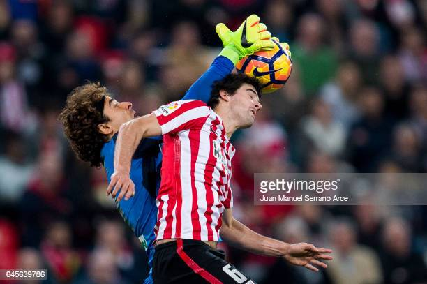 Guillermo Ochoa of Granada CF competes for the ball with Mikel San Jose of Athletic Club during the La Liga match between Athletic Club Bilbao and...