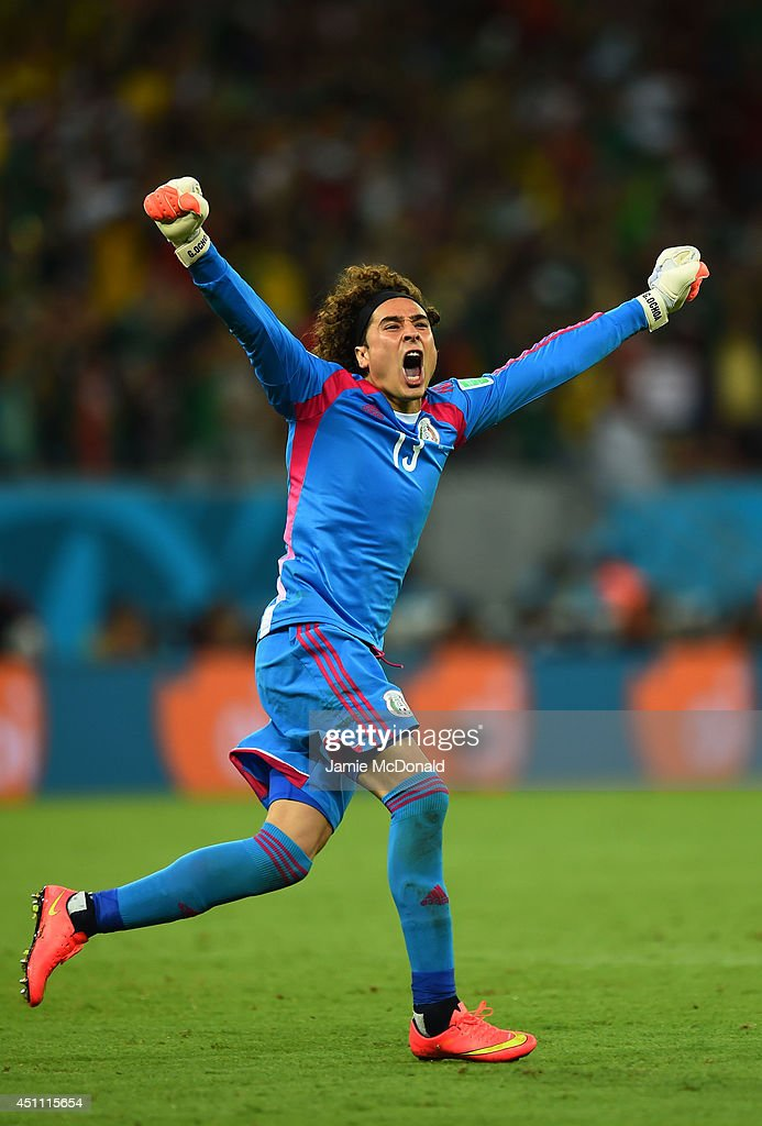 <a gi-track='captionPersonalityLinkClicked' href=/galleries/search?phrase=Guillermo+Ochoa&family=editorial&specificpeople=490875 ng-click='$event.stopPropagation()'>Guillermo Ochoa</a> of Mexico celebrates his team's first goal during the 2014 FIFA World Cup Brazil Group A match between Croatia and Mexico at Arena Pernambuco on June 23, 2014 in Recife, Brazil.