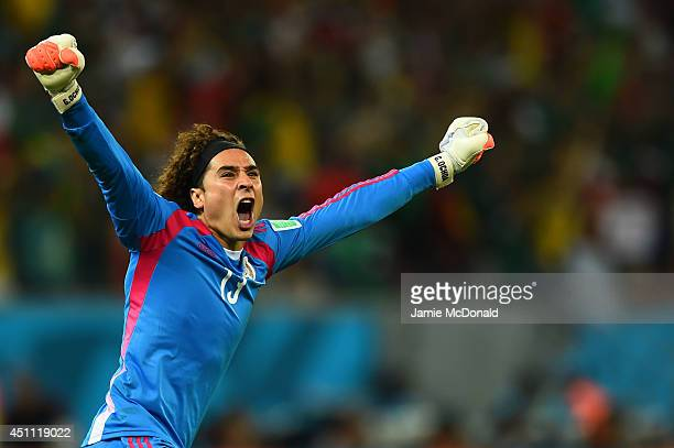 Guillermo Ochoa of Mexico celebrates his team's first goal during the 2014 FIFA World Cup Brazil Group A match between Croatia and Mexico at Arena...