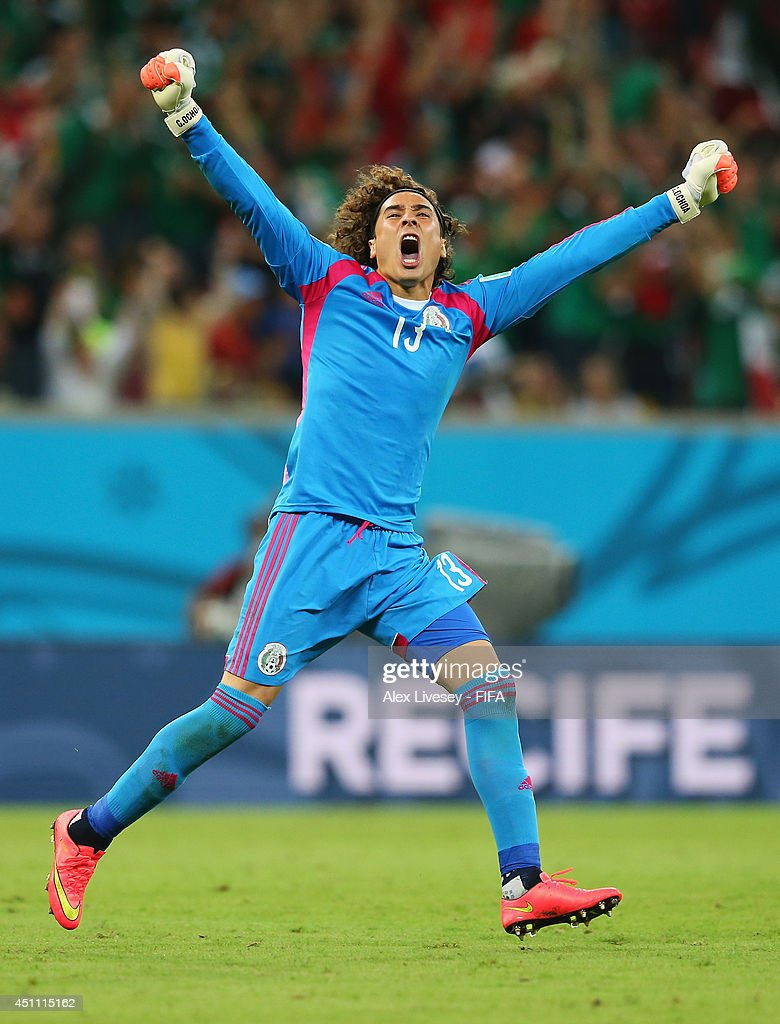 <a gi-track='captionPersonalityLinkClicked' href=/galleries/search?phrase=Guillermo+Ochoa&family=editorial&specificpeople=490875 ng-click='$event.stopPropagation()'>Guillermo Ochoa</a> of Mexico celebrates his team's first goal scored by Rafael Marquez (not pictured) during the 2014 FIFA World Cup Brazil Group A match between Croatia and Mexico at Arena Pernambuco on June 23, 2014 in Recife, Brazil.