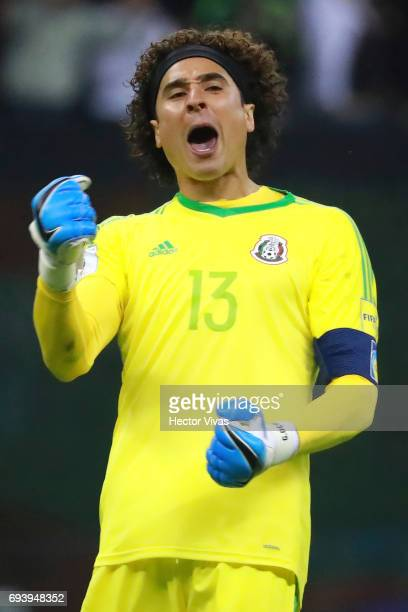 Guillermo Ochoa of Mexico celebrates the third goal of his team scored by his teammate Raul Jimenez during the match between Mexico and Honduras as...