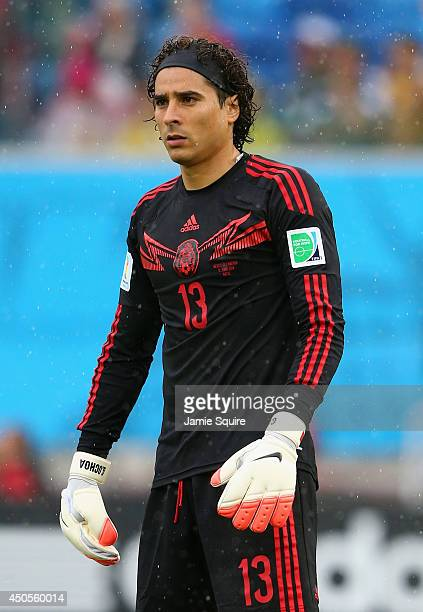 Guillermo Ochoa of Mexico looks on during the 2014 FIFA World Cup Brazil Group A match between Mexico and Cameroon at Estadio das Dunas on June 13...