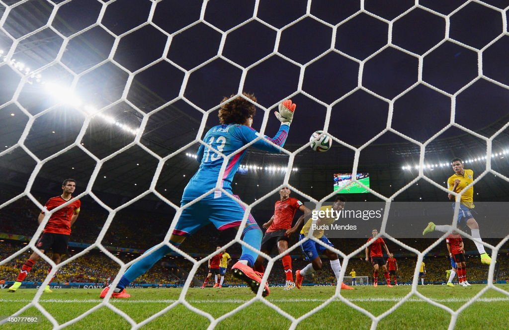 <a gi-track='captionPersonalityLinkClicked' href=/galleries/search?phrase=Guillermo+Ochoa&family=editorial&specificpeople=490875 ng-click='$event.stopPropagation()'>Guillermo Ochoa</a> of Mexico makes a save after a header by Thiago Silva of Brazil (R) during the 2014 FIFA World Cup Brazil Group A match between Brazil and Mexico at Castelao on June 17, 2014 in Fortaleza, Brazil.