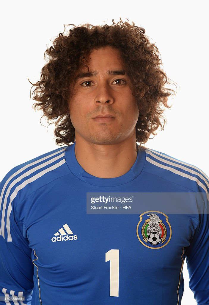 <a gi-track='captionPersonalityLinkClicked' href=/galleries/search?phrase=Guillermo+Ochoa&family=editorial&specificpeople=490875 ng-click='$event.stopPropagation()'>Guillermo Ochoa</a> of Mexico poses during portrait session ahead of the 2013 FIFA Confederations Cup at the Sheraton Rio Hotel on June 12, 2013 in Rio de Janeiro, Brazil.
