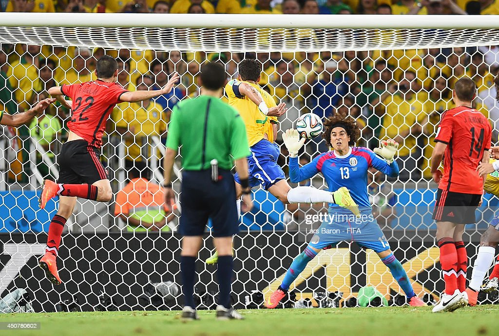 <a gi-track='captionPersonalityLinkClicked' href=/galleries/search?phrase=Guillermo+Ochoa&family=editorial&specificpeople=490875 ng-click='$event.stopPropagation()'>Guillermo Ochoa</a> of Mexico tries to stop a header by Thiago Silva of Brazil during the 2014 FIFA World Cup Brazil Group A match between Brazil and Mexico at Estadio Castelao on June 17, 2014 in Fortaleza, Brazil.