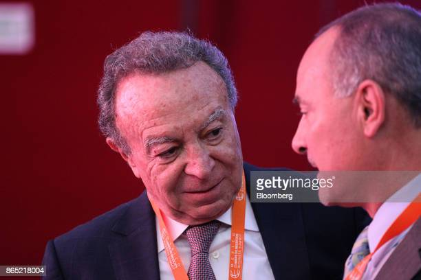 Guillermo Ortiz chairman of Mexico and Latin American at BTG Pactual Group left speaks with a delegate during the Mexico Business Summit in San Luis...