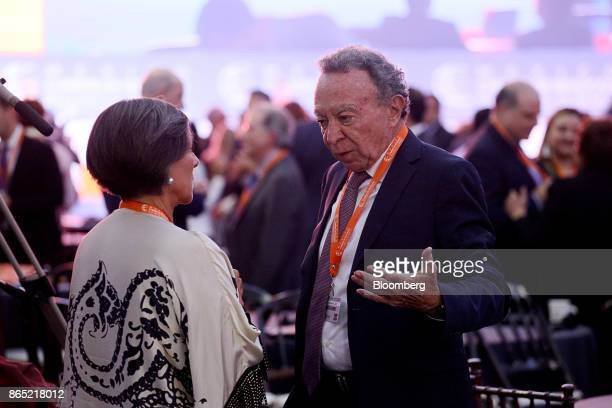 Guillermo Ortiz chairman of Mexico and Latin American at BTG Pactual Group right speaks with a delegate during the Mexico Business Summit in San Luis...