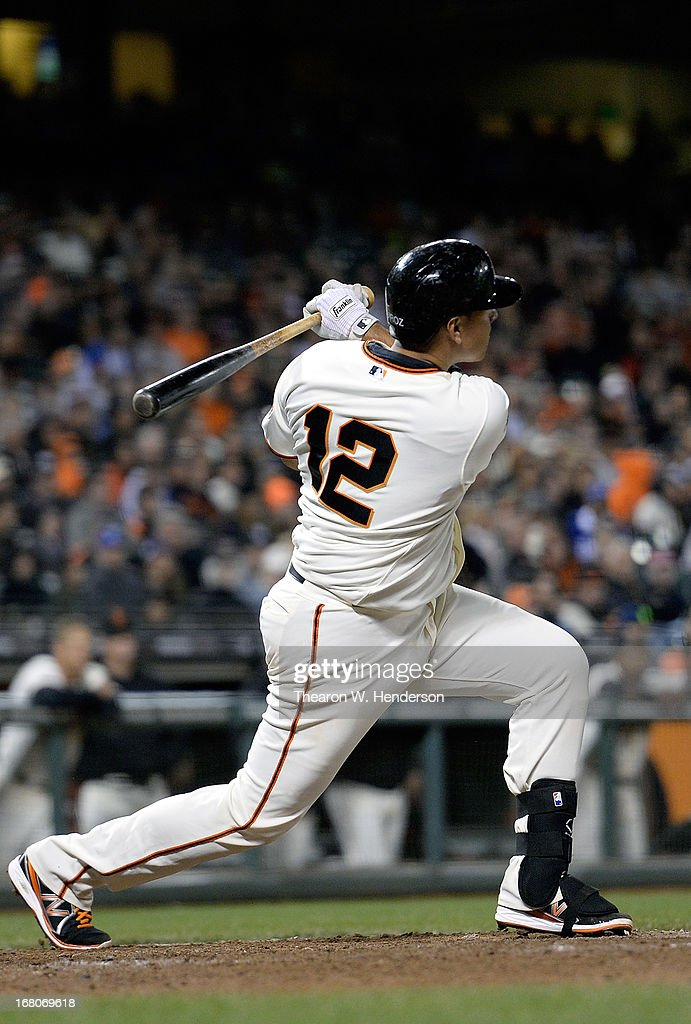 Guillermo Quiroz #12 of the San Francisco Giants hits a solo walk-off homer against the Los Angeles Dodgers in the bottom of the tenth inning to defeat the Dodgers 10-9 at AT&T Park on May 4, 2013 in San Francisco, California.