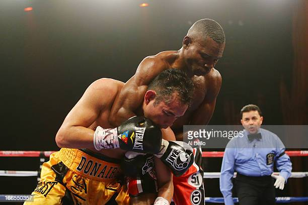 Guillermo Rigondeaux headlocks Nonito Donaire during their WBO/WBA junior featherweight title unification bout at Radio City Music Hall on April 13...
