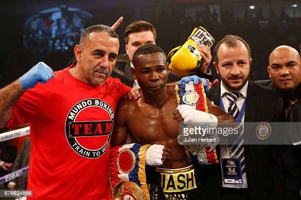 Guillermo Rigondeaux of Cuba and his team after beating Jazza Dickens of Great Britain in their WBA SuperBantamweight Championship bout at Cardiff...