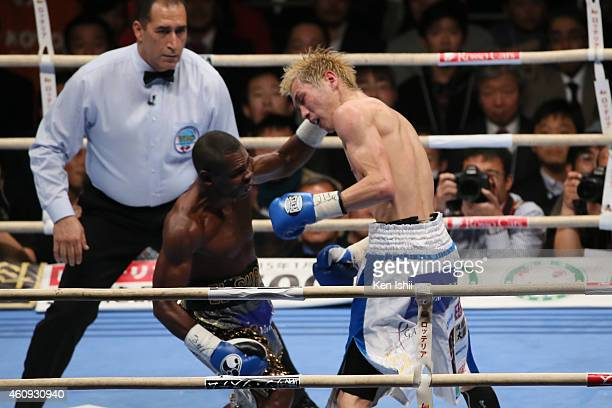 Guillermo Rigondeaux of Cuba and Hisashi Amagasa of Japan exchange punches during the WBA/WBO world super bantamweight bout between Guillermo...