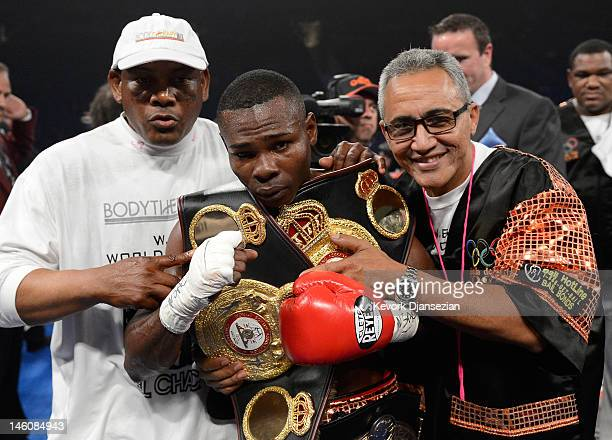 Guillermo Rigondeaux poses for a photo with his belts after knocking out Teon Kennedy during their WBA super bantamweight title fight at MGM Grand...
