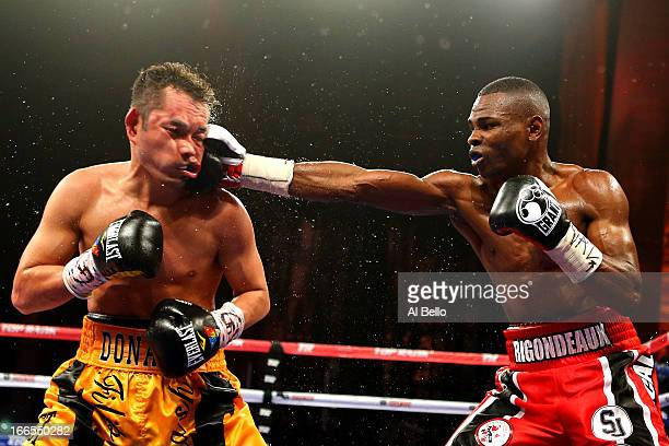 Guillermo Rigondeaux punches Nonito Donaire during their WBO/WBA junior featherweight title unification bout at Radio City Music Hall on April 13...