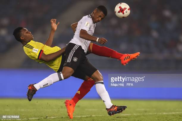 Guillermo Tegue of Colombia and Jessic Ngankam of Germany battle for the ball during the FIFA U17 World Cup India 2017 Round of 16 match between...