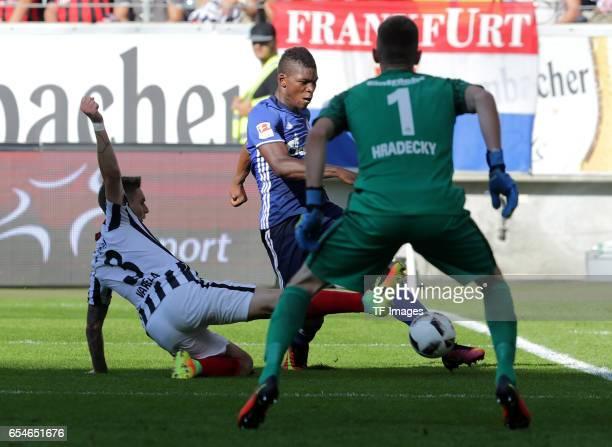 Guillermo Varela of Frankfurt Abdul Rahman Baba of Schalke and Goalkeeper Lukas Hradecky of Frankfurt battle for the ball during the Bundesliga match...
