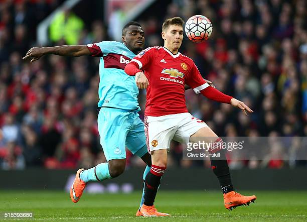 Guillermo Varela of Manchester United holds off Emmanuel Emenike of West Ham United during the Emirates FA Cup sixth round match between Manchester...