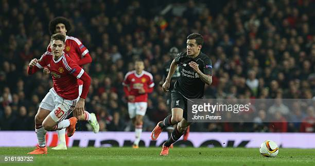 Guillermo Varela of Manchester United in action with Philippe Coutinho of Liverpool during the UEFA Europa League Round of 16 Second Leg match...